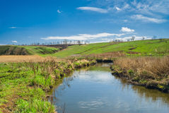 Rural landscape with small river Royalty Free Stock Photo