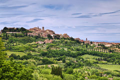 Rural landscape with a small town in Tuscany. Italy Stock Photography