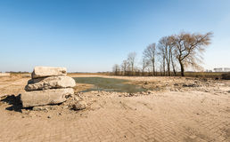 Large chunks concrete stacked in a rural landscape Stock Photography