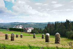 Rural Landscape with stacks of mown hay against the background of mountains Western Carpathians. Rural Landscape with stacks of mown hay in Silesian Voivodeship Royalty Free Stock Images