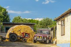 Rural landscape. Stockpiles of hay in the yard stock photos