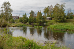 Rural landscape. Rural summer landscape with houses and fisherman in the background Royalty Free Stock Images