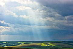 Rural landscape with sunbeam Stock Images