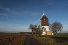 Rural landscape on a sunny spring day. Tower in the field.Rural landscape in sunny spring day royalty free stock image
