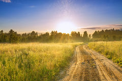 Rural landscape with sunrise  and the road Royalty Free Stock Image