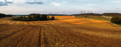 Rural landscape at sunset. Plowed field after harvest Royalty Free Stock Photos