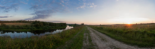 Rural landscape, sunset. The road stretches into the distance, the river on the left side. Shirov panoramma Royalty Free Stock Images