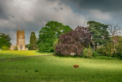 Rural landscape with 12th Century Church of The Holy Trinity in Wickwar royalty free stock photo