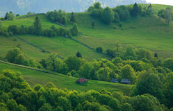 Rural landscape village and fields in mountains Stock Photos