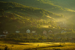 Rural landscape village and fields in mountains at dawn Royalty Free Stock Photography