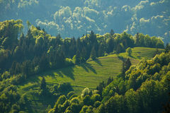 Rural landscape village and fields in mountains at sunlight Royalty Free Stock Photography