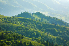 Rural landscape village and fields in mountains at sunlight Stock Photography