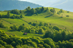 Rural landscape village and fields in mountains at sunlight Royalty Free Stock Photo