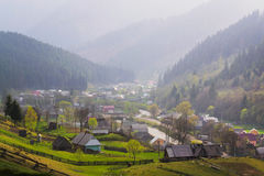 Rural landscape with village houses and mountains Stock Images