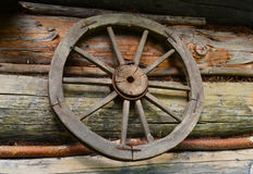 Rural landscape in vintage style with old wooden wheel close up Royalty Free Stock Photography