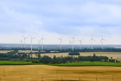 Rural landscape with wind turbines. Farm, wide angle shot Royalty Free Stock Image