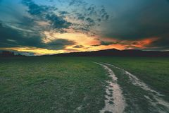 Free Rural Landscape With A Curved Road Royalty Free Stock Images - 162150449
