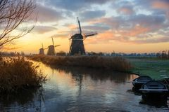 Free Rural Landscape With Windmills In Holland At Sunrise Stock Photos - 136199263