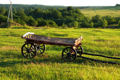 Rural landscape with wooden cart Stock Photos