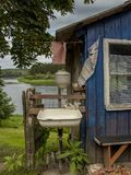 Old rural  outdoor utility sink and wooden summer kitchen. Summer landscape background. Rural landscape - wooden outdoor kitchen in village  Lithuania. Europe Royalty Free Stock Photos