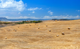 Rural landscapes of Tuscany, Italy. Bales and haystacks on the hills and fields. Rural landscapes of Tuscany, Italy, Europe. Lots of round bales and haystacks royalty free stock image