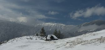 Rural lanscape. A rural landscape in Romanian mountains by winter Royalty Free Stock Photography