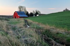 Rural lanscape with red barn in Palouse Stock Image