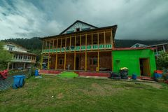 Rural life in himalayas - a himachali traditional house in sainj valley in front of Himalayas stock photos