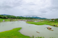 Rural life view of wooden Mon Bridge in Sangkhla Buri Royalty Free Stock Photography