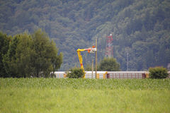 Rural Linemen. Linemen work on electrical lines in a remote, rural area Stock Images