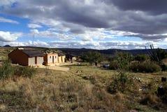 Rural Living. Rural house in South Africa. Menacing clouds overhead, promising rain Stock Image