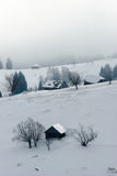 Rural lodge in winter Royalty Free Stock Photography