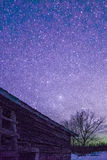 Rural Log Cabin barn at night with stars and milky way Royalty Free Stock Images