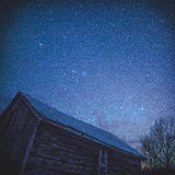 Rural Log Cabin barn at night with stars and milky way Royalty Free Stock Photo
