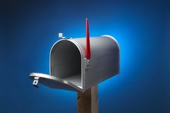 Rural mail box. Rural metal mail box opened and sitting on wood post Royalty Free Stock Photography