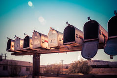 Rural mail boxes. In row on the roadside stock photo