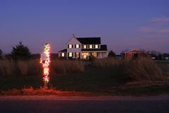 Rural Mailbox Decorated for Christmas. Rural mailbox decorated with 300 Christmas lights in front of a country house Stock Image