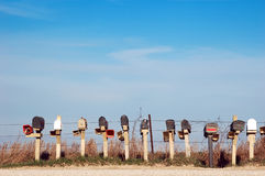 Rural mailboxes. A row of mailboxes along a rural road in Iowa royalty free stock images