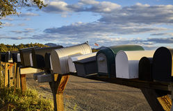 Rural Mailboxes with US Flag in Distance Stock Photography