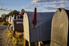 Rural Mailboxes with US Flag in Distance Royalty Free Stock Photography