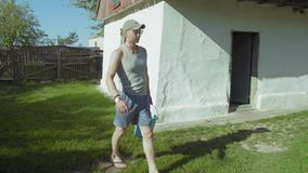 Rural Man Brings Home a Water Bucket from a Spring stock video