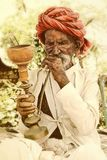 Rural Man Smoking. Seniore old man smoking pipe from village of rajasthan-india Stock Image
