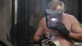 Rural Man is Welding stock video footage
