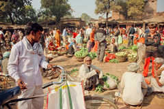 Rural market in India full of villagers buying vegetables and greens Royalty Free Stock Photo