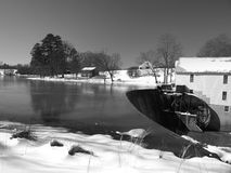 Rural mill. Winter Scene at a rural pond and mill. Shown in black and white Stock Image