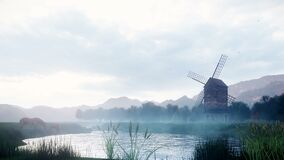 A rural misty morning landscape with an old windmill and horses next to a pond, grasses and plants swaying in the wind