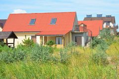 Rural modern house with red roof, balcony and skylight. Photo royalty free stock images