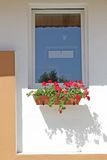 Rural modern window. Window, white wall and red flowers Royalty Free Stock Images