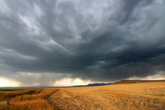 Rural Montana Storm Clouds. Dark storm clouds thunder across the plains of rural Montana on a fall day Royalty Free Stock Photography