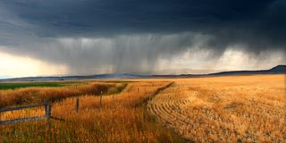 Rural Montana Storm Clouds. Dark storm clouds thunder across the plains of rural Montana on a fall day Stock Images